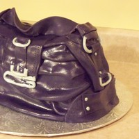 "Purple Guess Purse Buttercream frosting - covered with fondant. all details made with fondant.created for a lady who's just going ""gaga"" for..."