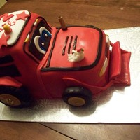Red Tractor For Kael White vanilla Pound cake with ButterCream frosting. - covered with fondant.Red tractor.. cartoon type for a 2yr special boy.