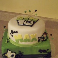 Ben 10 Birthday Boy favorite Cartoon.White Pound cake with Buttercream frosting .. covered with fondant. All details done in Fondant.