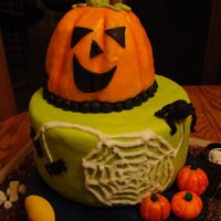 Halloween Cake This is my DDs first attempt at a stacked cake. The pumpkin is carved and covered in homemade fondant. The other two layers are covered in...