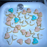Bite Size Beauties! Valentine Cookies Used the fondant mini heart cut out for sugar cookies. After they came out of the oven I put a cut out of MMF on top. Yummy and bite size....