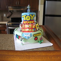 Toy Story Birthday Cake MMF and toys bought for cake. Inspiration from all the toy story cakes I have seen. I made this for my sons 2nd birthday.