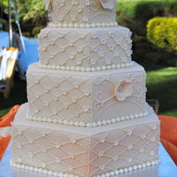 Ivory Hexagon Cake I loved making this cake. The bride chose ivory fondant with ivory details. The large flowers were made with my cricut and the small...