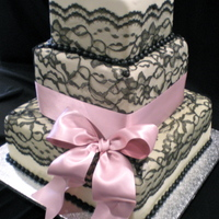 Sexy Black Lace With A Cute Pink Ribbon! I made this cake with fondant and real black lace and ribbon. The bride chose some fun colors, I was pretty happy with the way it turned...