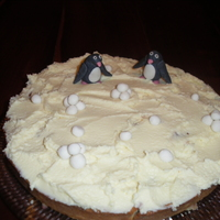 Winter fruit cake with white ganache and fondant penguins