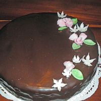 100% Chocolat! Sacher Cake with apricot jam under chocolat ganach icing with fondant roses