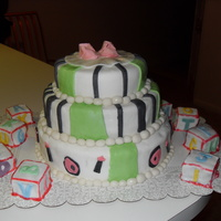 Baby Shower Cake This is my 2nd cake with fondant and gumpaste. I made the blocks out of cake squares and fondant. The cake itself is full of stripes and...