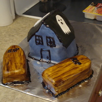 Haunted Cottage Cake The cottage is a spice cake with cream cheese icing and fondant! It is 100% edible. The coffins are handpainted and are also spice cake...