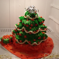 Christmas Tree Cakes  This cake is 25 mini cakes, strawberry and vanilla pound cakes individually icing with buttercream icing and fondant stacked into a...