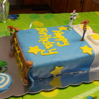 Toy Story Cake   Toy story bed cake, characters are not edible due to lack of time! Strawberry cake with buttercream icing covered in marshmallow fondant!
