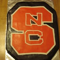 Nc State Grooms Cake   Red velvet, cream cheese icing, marshmallow fondant. North Carolina State University symbol!