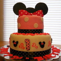 Minnie Mouse Cake   Yellow cake with buttercream and marshmallow fondant! Gum paste ears and minnie heads. 1 year birthday cake!