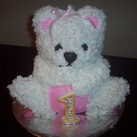 First Birthday Teddy Bear White teddy bear with pink detail. White cake with buttercream frosting. Made with the stand up bear pan from Wilton
