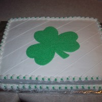 St. Patty's Day Half sheet cake with buttercream frosting. Plain and simple shamrock.