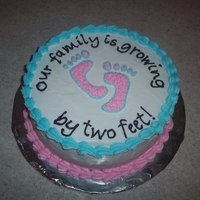 "Our Family Is Growing... 8"" round cake with buttercream frosting. Announcing the arrival of a little one..."