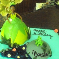 Princess Tiana butter cake soaked in pineapple almond syrup covered with a grape buttercream and colored fondant