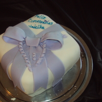 Present   yellow cake with fondant decorations