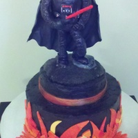 Darth Vader Cake Chocolate cake with chocolate buttercream died black. Fondant flames. Darth Vader is supported with a fat straw through his right leg (and...