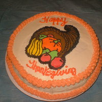 Thanksgiving Cornucopia A Pumpkin cake with cream cheese buttercream icing and a frozen buttercream transfer