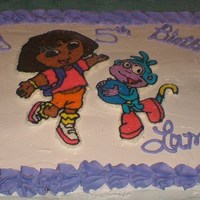 Dora The Explorer Dora The Explorer. Yellow cake, Buttercream Icing with a Frozen Butter Cream Transfer