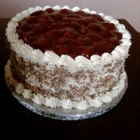 Strawberry Gateaux whipped cream icing with fresh strawberries and milk chocolate curls