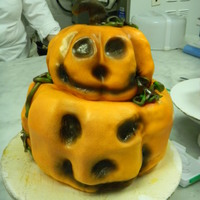 Jack O'lantern Cake Pumpkin carved from cake layers and covered with fondant