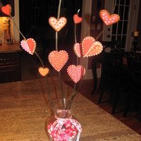 Vaentine's Day Cookie Vase Gingerbread cookies with color flow icing attached to branches with royal icing and placed in a vase with ribbin and m n m's!