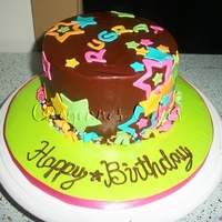 Starss   yellow cake with chocolate frosting. Modeling chocolate stars and swirls. candy confetti