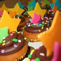 Stars Stars Stars   yellow cake wit chocolate frosting. Modeling chocolate stars and candy confetti.