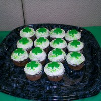 Shamrock Cupcakes chocolate cupcakes with vanilla bc. the shamrocks are made from royal icing.