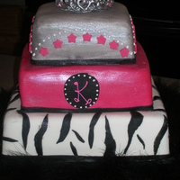 Sweet 16 Here's my 2nd cake. I was so excited to try a RI tiara. My first broke, but this one worked out. I LOVED making this cake. The middle...