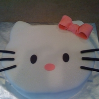 Hello Kitty Hello Kitty shaped fondant covered cake. Vanilla with cookies and cream filling. Glittery, but you can't tell in this picture. Thank...