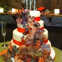 Fall Themed Wedding Cake  four tiers, 2 each of banana/choc buttercream and champagne/strawberry buttercream. Rolled buttercream fondant, satin ribbon and gumpaste...
