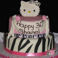 Hello Kitty Couture Fondant cake with fondant/gumpaste accents. Rolled pink and zebra print roses. Hello Kitty gumpaste topper (head and bow) cut and painted...