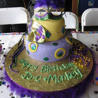 "Mardi Gras Made for a Mardi Gras theme. I wish I had gotten a better picture. 6"" & 10"". Hand made mask cake toppers. Fondant cake w/..."