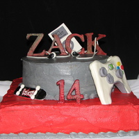 """all His Favorite Things"" Buttercream cake with fondant accessories."