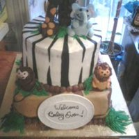 Safari Cake Animals are made out of brownie pops and fondant. Cake is frosted with buttercream with fondant accents added.