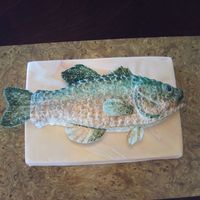 Bass Fish Fish is cake covered in fondant...sitting on top of a marbled fondant cake