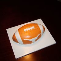Ut Football cake shaped into a football and covered in fondant
