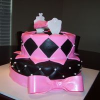 Monogrammed Baby Shower Cake pink and black monogrammed cake all out of fondant - cradle is out of gumpast