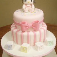 Baby Hello Kitty This was my first baby shower cake. The cake is vanilla covered with strawberry buttercream, and strawberry filling. The blocks were rice...