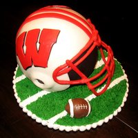 Wisconsin Football Helmet I made this for my friends birthday. He is a huge Wisconsin fan especially football. It was alternating pound cake and chocolate cake. I...
