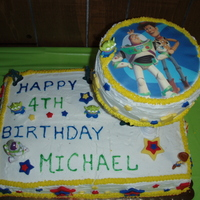 Toy Story Cake This is Toy Story Cake. Chocolate cake covered in buttercream with MMF stars. Also decorated with Toy Story figurines.