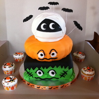 Halloween Bday Cake Loved making this cake with a ghost, pumpkin and frank....