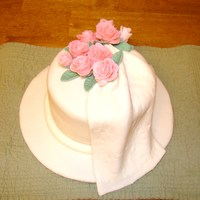 "Pink Roses With Floral Imprint Drape  8 x 4 "" round cake covered in white fondant, along with board. Floral imprint white fondant and gum paste drape, with pink fondant..."