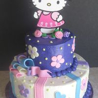 "Hello Kitty Birthday Cake  Another 10 and 6"" all Yellow cake with buttercream icing and fondant decorations. Hello Kitty is just cut out from a picture and put..."
