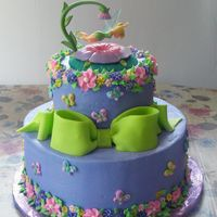 "Tinkerbell Cake 2 tier 10"", 6"" all chocolate cake iced in buttercream with royal icing flowers. Thanks for looking!"
