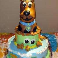 "Scooby Doo 10"" and 6"" tiered cake with Scooby made out of Rice Krispy Treats on top. Scooby snacks are actually graham crackers that they..."