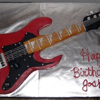Electric Guitar This is my first carved guitar cake..carved from half sheet cake, Red Velvet with buttercream icing and fondant decorations. Thanks! :)