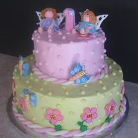 "Fairy Birthday Cake These are my second attempt at fondant figures, this time they are fairies.. The cake itself is a 10 and 6"" chocolate and vanilla with..."